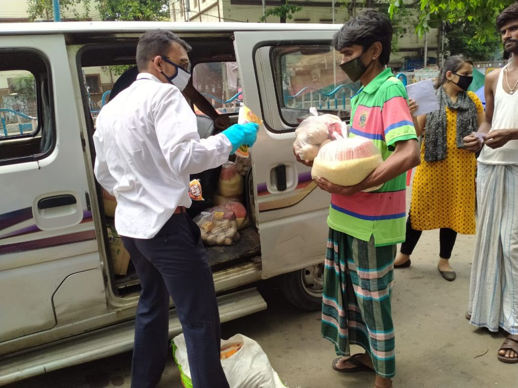 Distributing food rations to the destitute of Central Kolkata during COVID-19 lockdown